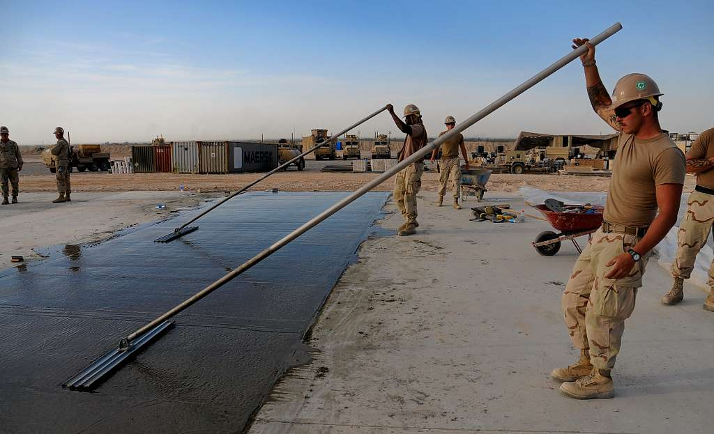 Seabees assigned to Naval Mobile Construction Battalion (NMCB) 40 place concrete for a project at Camp Deh Dadi II, Afghanistan.