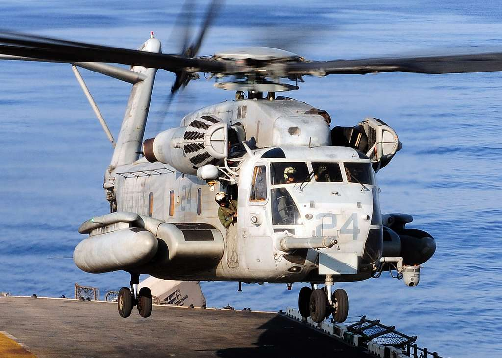 A CH-53E Sea Stallion helicopter assigned to Marine Medium Helicopter Squadron (HMM) 262, takes off from the flight deck of the forward-deployed amphibious assault ship USS Essex (LHD 2).