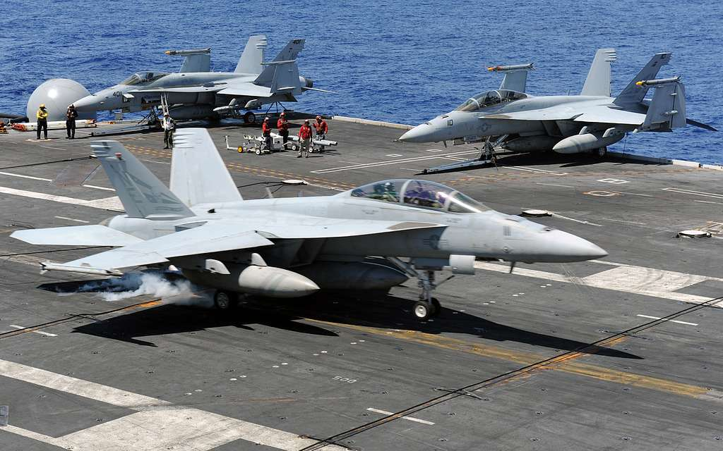 An F/A-18F Super Hornet assigned to the Blue Blasters of Strike Fighter Squadron (VFA) 2 lands on the flight deck of the aircraft carrier USS Abraham Lincoln (CVN) 72.
