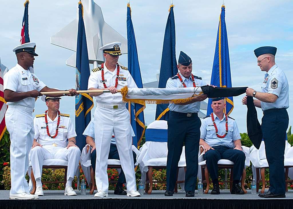 Capt. Rick Kitchens, center left, commander of Joint Base Pearl Harbor-Hickam and Col. Charles Baumgardner,