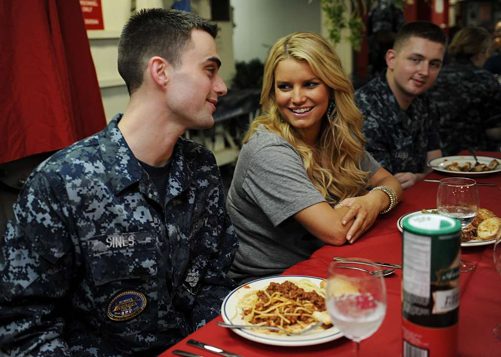 Information Systems Technician Seaman Todd Sines speaks with singer/actress Jessica Simpson on the mess decks during a USO and Navy Entertainment sponsored visit aboard USS Harry S. Truman (CVN 75).