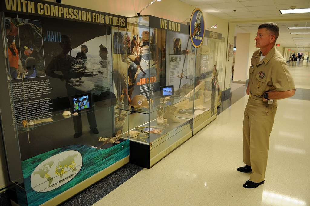 Master Chief Petty Officer of the Navy (MCPON) Rick West takes a look at the Seabee display at the Pentagon.