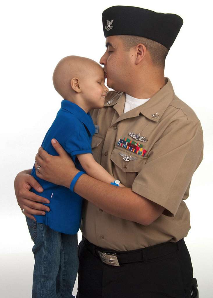 Personnel Specialist 2nd Class Enrique Ramirez hugs his 4-year-old daughter, Arianna, during a photography session.