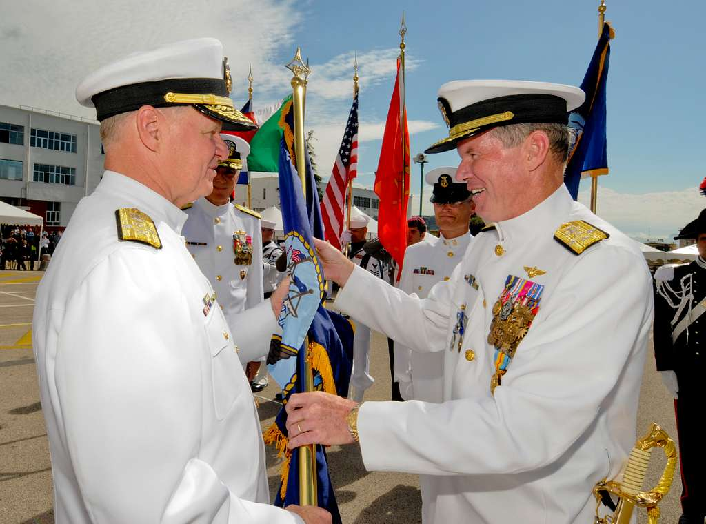 Adm. Mark Fitzgerald, right, passes the U.S. Navy flag to Chief of Naval Operations (CNO) Adm. Gary Roughead