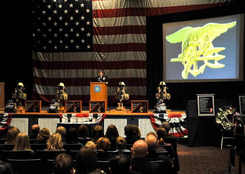 ear Adm. (SEAL) Edward G. Winters, commander of Naval Special Warfare Command, delivers remarks during a memorial service