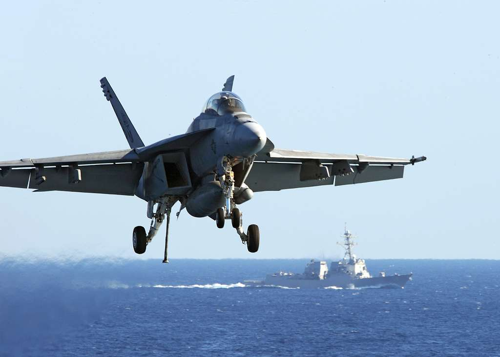 An F/A-18F Super Hornet assigned to the Red Rippers of Strike Fighter Squadron (VFA) 11 prepares to make an arrested landing aboard the aircraft carrier USS Enterprise (CVN 65)