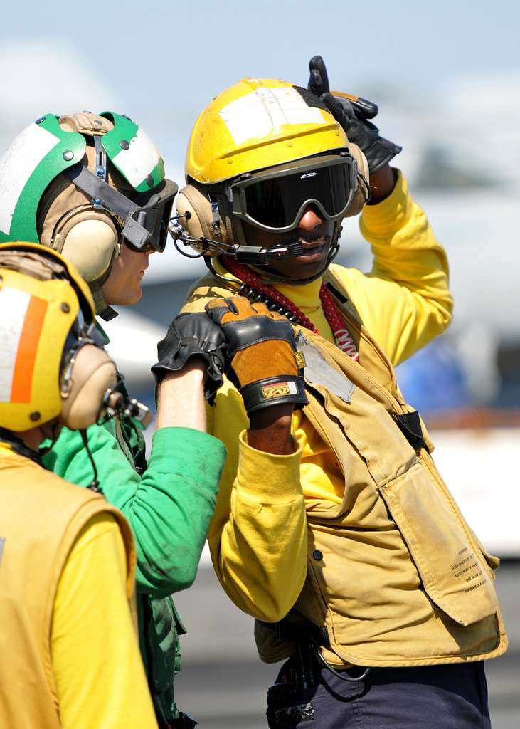 Sailors communicate during a mass casualty drill on the flight deck of the aircraft carrier USS George H.W. Bush (CVN 77).