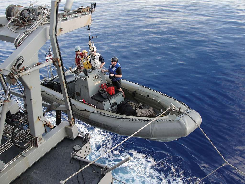 Sailors aboard the guided-missile cruiser USS Leyte Gulf (CG 55) conduct rigid-hull inflatable boat operations.
