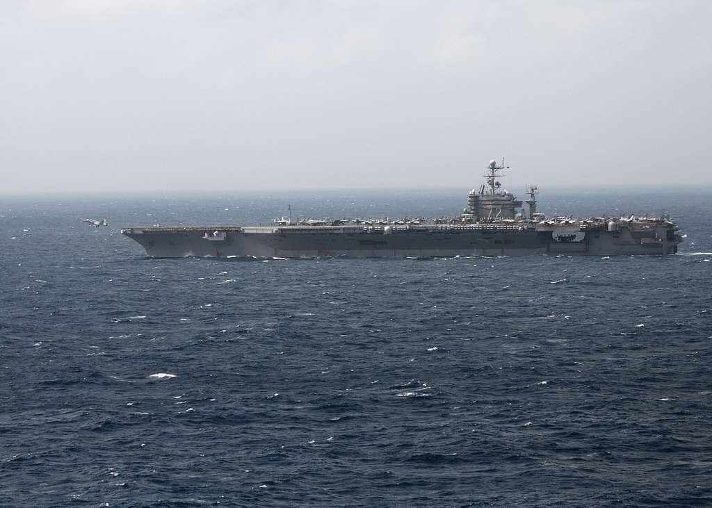 An F/A-18 Hornet launches from the aircraft carrier USS Abraham Lincoln (CVN 72).