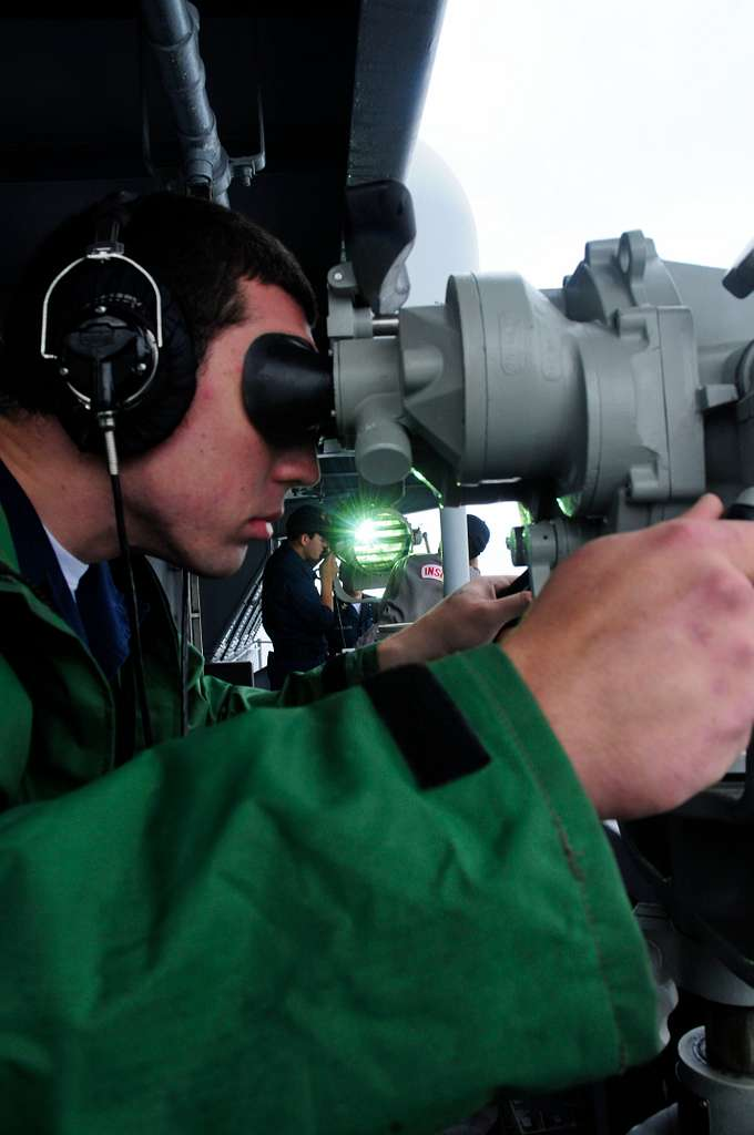 Boatswain's Mate Seaman Nick Storgion stands the forward look-out watch aboard the aircraft carrier USS Carl Vinson (CVN 70), while Board of Inspection and Survey (INSURV) inspections take place on signal lights.