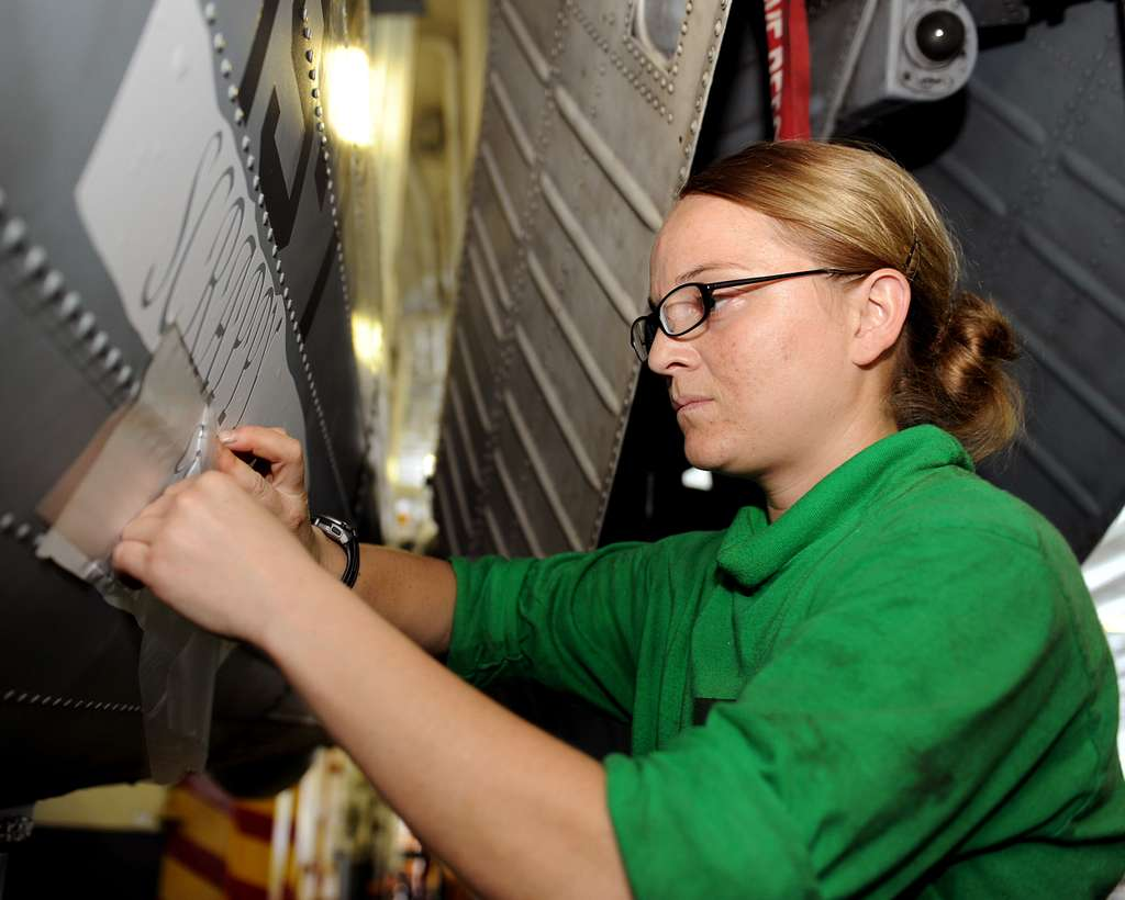 Aviation Structural Mechanic Airman Cassie Renfro, from Garden Valley, Idaho, assigned to the Dusty Dogs of Helicopter Anti-submarine Squadron (HS) 7,