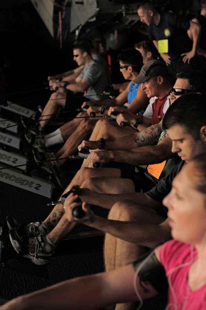 Sailors row 1600 meters during a triathlon aboard the aircraft carrier USS Abraham Lincoln (CVN 72).
