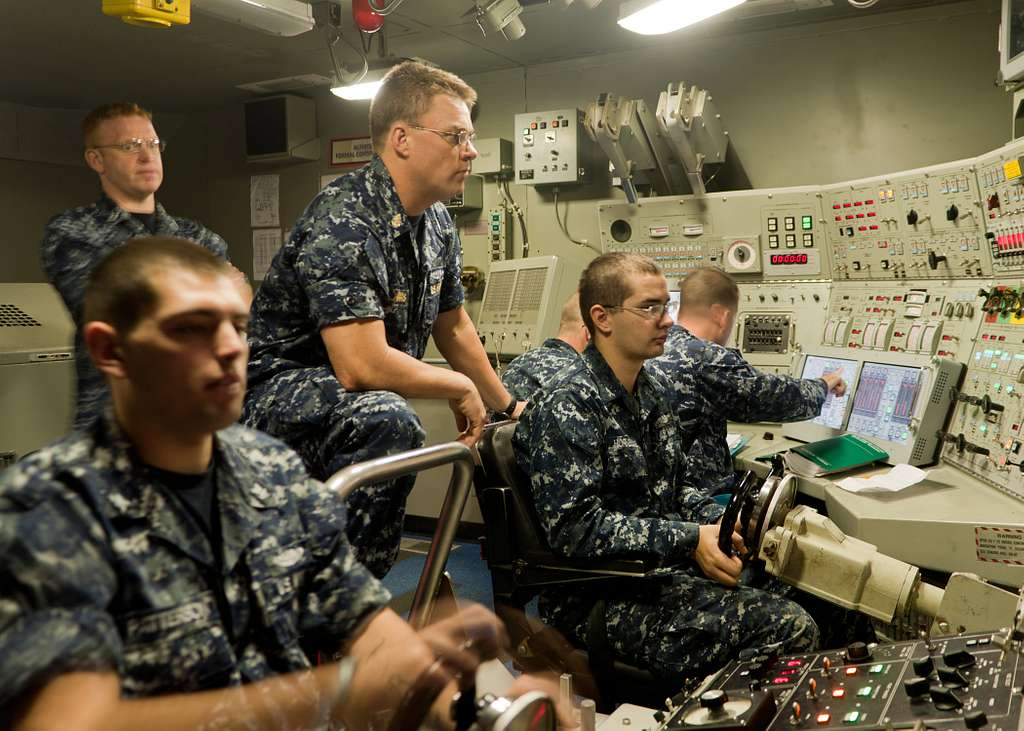 Senior Chief Missile Technician Wyatt Harris, center, Blue Team assistant navigator aboard the ballistic-missile submarine USS Florida (SSBN 728),