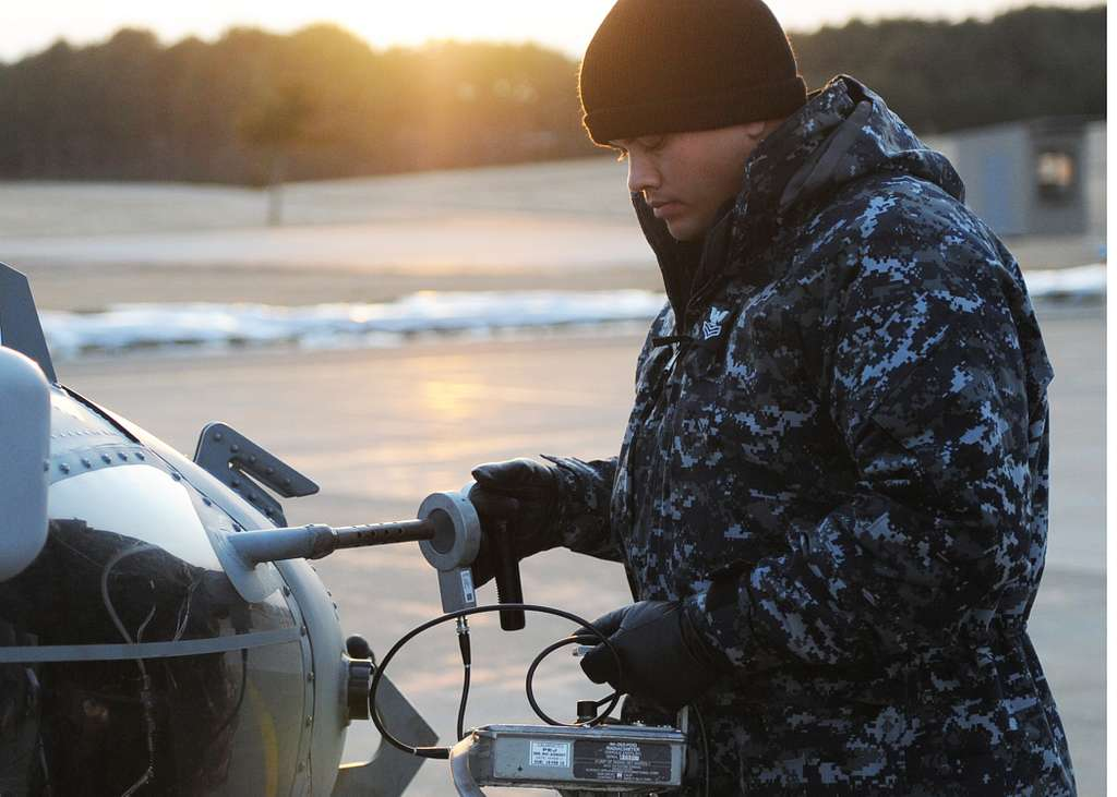 Machinist's Mate 1st Class Jason Huffman, from Guthrie, Okla., assigned to Nuclear Regional Maintenance Department, Kings Bay Ga., conducts a post sortie assessment