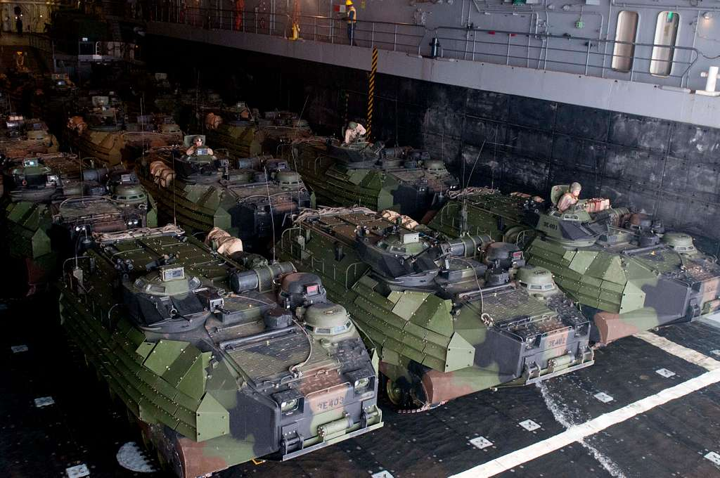 Amphibious assault vehicles prepare to depart the well deck of the San Antonio-class amphibious transport dock ship USS New Orleans (LPD 18). - PICRYL Public Domain Image