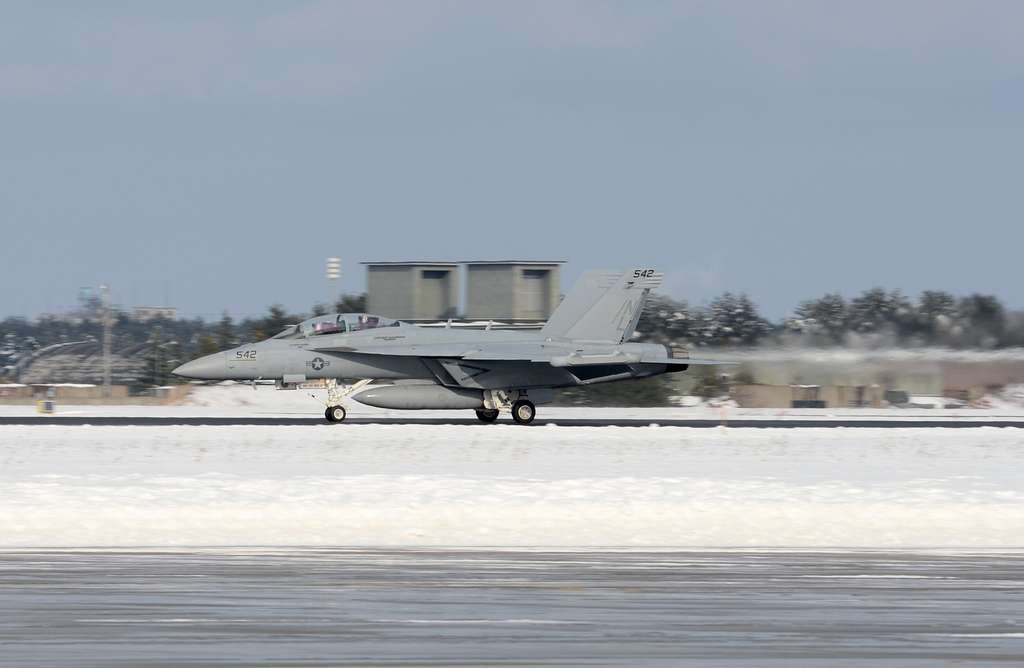 An EA-18G Growler from Electronic Attack Squadron (VAQ) 132 lands on the runway at Misawa Air Base.