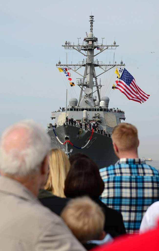 Family and friends wave as the guided-missile destroyer USS Laboon (DDG 58) returns to homeport at Naval Station Norfolk after completing an eight-month deployment.