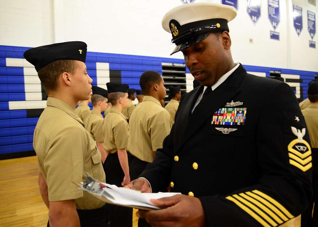 Senior Chief Fire Controlman Claude Henderson, from Afloat Training Group (ATG), Atlantic, inspects a cadet during an off-site inspection of the Norview High School Navy Junior ROTC
