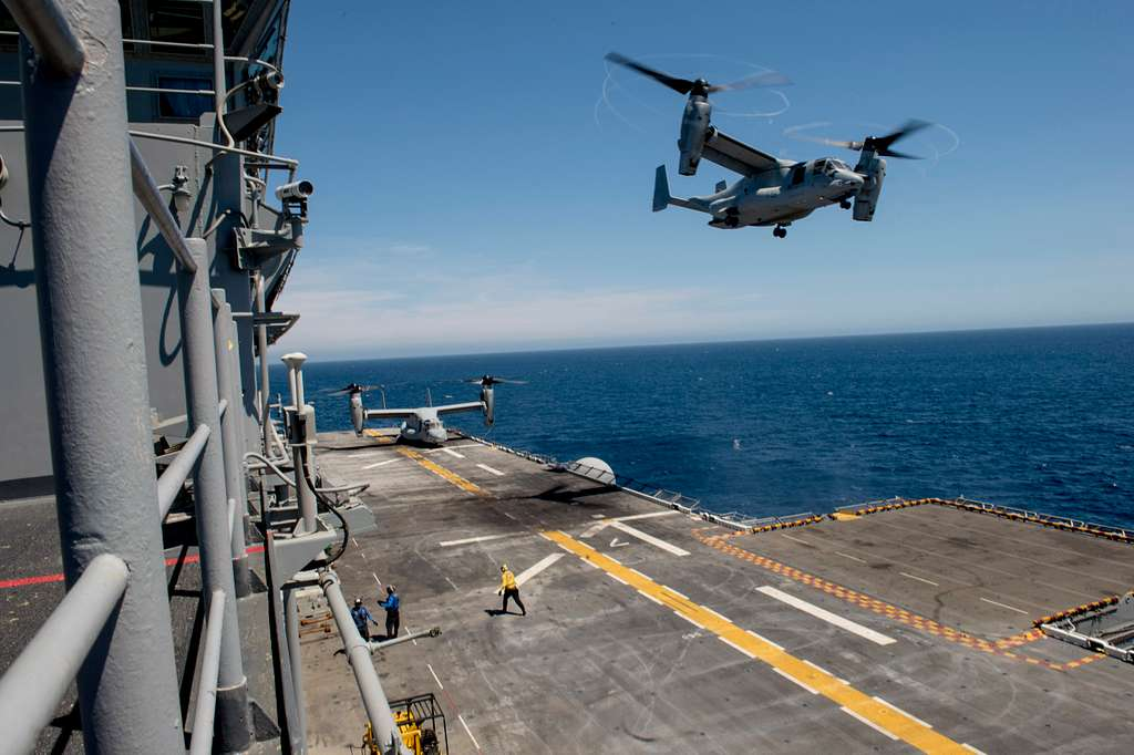 An MV-22 Osprey assigned to the Marine Medium Tilt-rotor Squadron (VMM) 166 (Reinforced) takes off from the flight deck of the amphibious assault ship USS Boxer (LHD 4).
