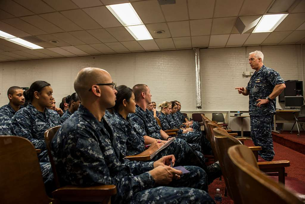 Capt. John F. Meier, commanding officer of the aircraft carrier Pre-Commissioning Unit (PCU) Gerald R. Ford (CVN 78), addresses his junior personnel at an E-3 and below CO's call.