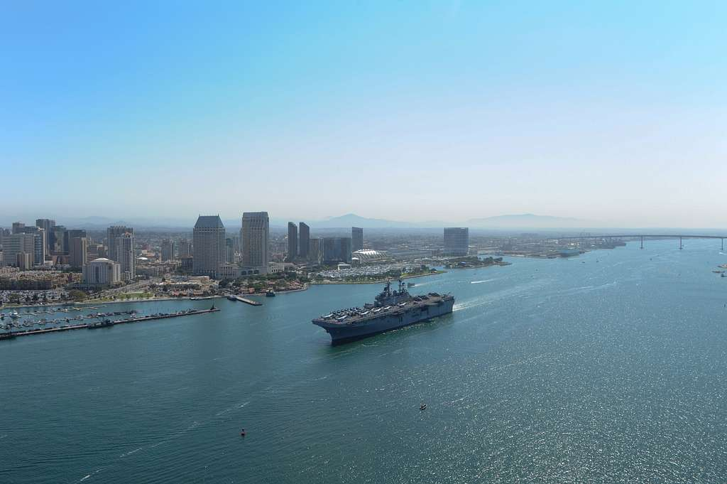 The amphibious assault ship USS Boxer (LHD 4) transits San Diego Bay while getting underway for a deployment as part of the Boxer Amphibious Ready Group (ARG).