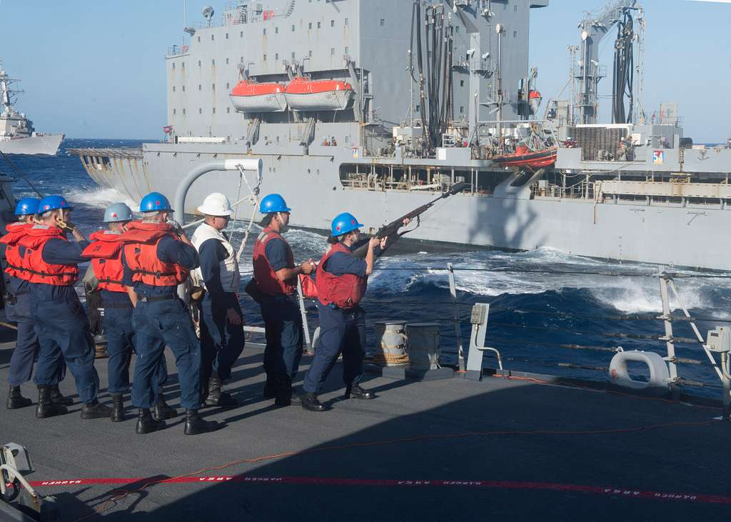 Sailors fire a shot line from the Arleigh Burke-class guided-missile destroyer USS Stout (DDG 55) to the Military Sealift Command fleet replenishment oiler USNS Laramie (T-AO 203) during a replenishment-at-sea.