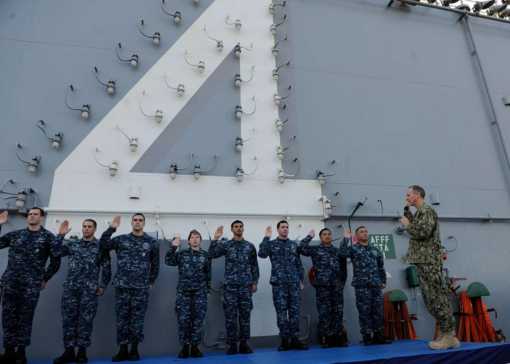 Chief of Naval Operations (CNO) Adm. Jonathan W. Greenert re-enlists Sailors aboard the amphibious assault ship USS Boxer (LHD 4). Boxer is the flagship for the Boxer Amphibious Ready Group and,