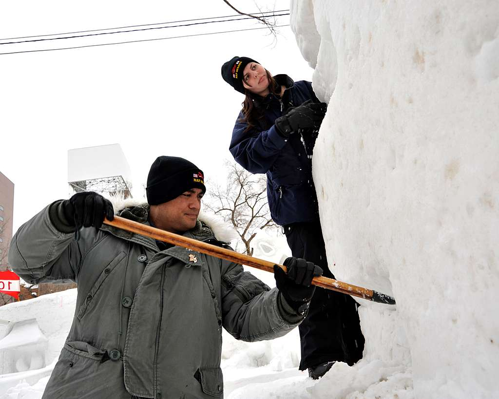 Chief Builder Billy Harger, from Pearl City, Hawaii, and Cryptologic Technician (Collection) 2nd Class Alexianna Morton, from Antioch, Calif., shape a snow sculpture for the 65th Annual Sapporo Snow Festival.