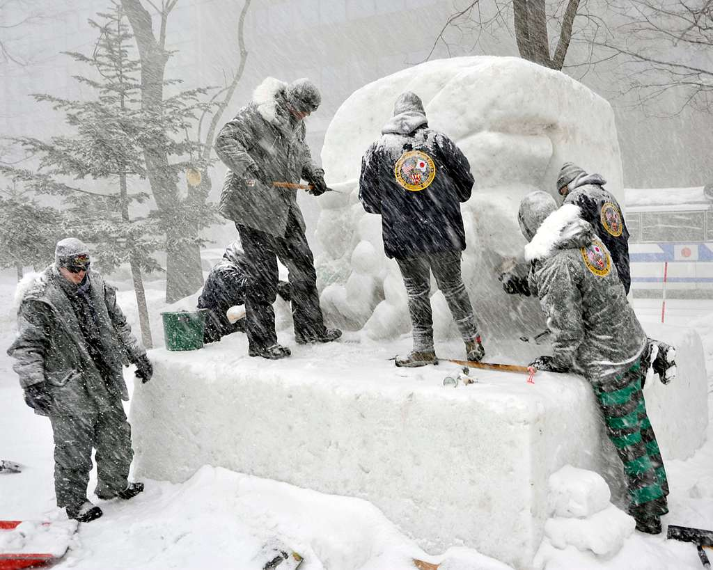 The 2014 Navy Misawa Snow Team endure intense winter weather, Jan. 31, 2014, as they create a snow sculpture in time for the 65th Annual Sapporo Snow Festival.