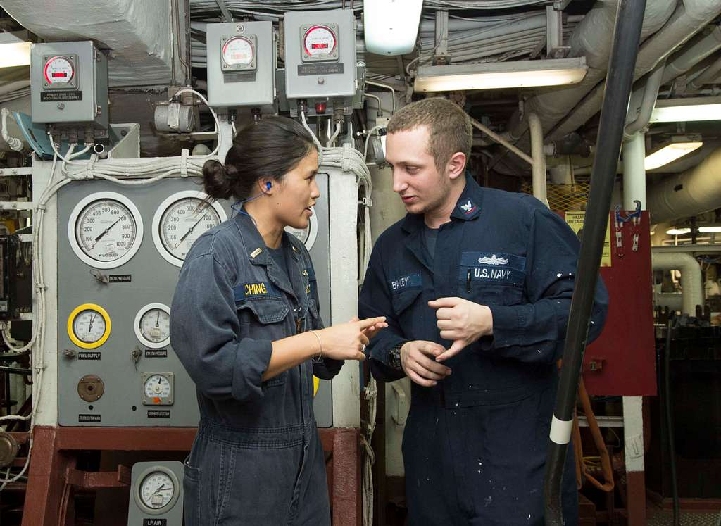 Enginemen 3rd Class Tyler Bailey conducts training with Ensign Jaycie Ching aboard the amphibious assault ship USS Boxer (LHD 4).