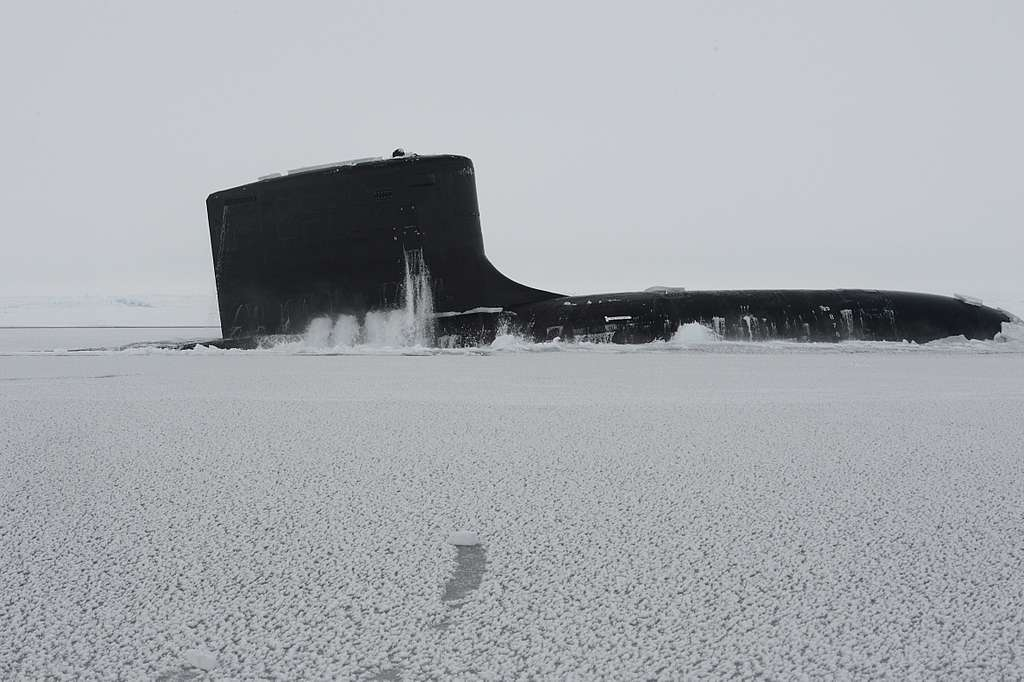 The Virginia-class attack submarine USS New Mexico (SSN 779) surfaces through the arctic ice during Ice Exercise (ICEX) 2014.