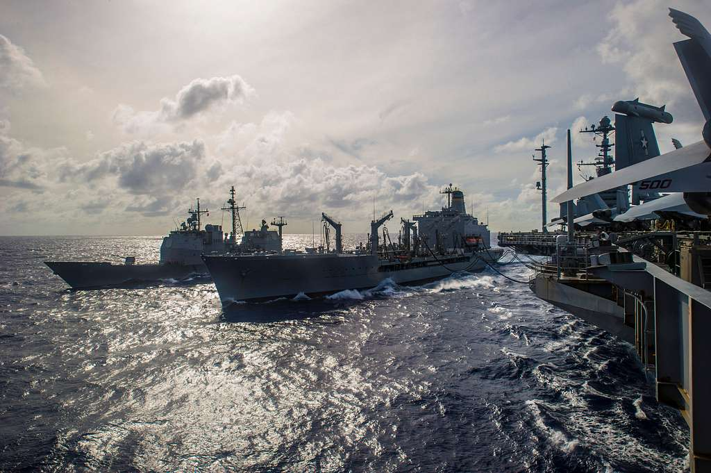 The  Military Sealift Command fleet replenishment oiler USNS Rappahannock (T-AO 204), center, and the Ticonderoga-class guided-missile cruiser USS Antietam (CG 54).