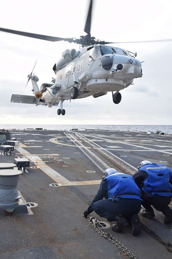 An SH-60K Sea Hawk helicopter from the Japan Maritime Self-Defense Force (JMSDF) prepares to land on the flight deck of the Arleigh Burke-class guided missile destroyer USS McCampbell (DDG 85) as part of the annual bilateral Guam Exercise (GUAMEX).