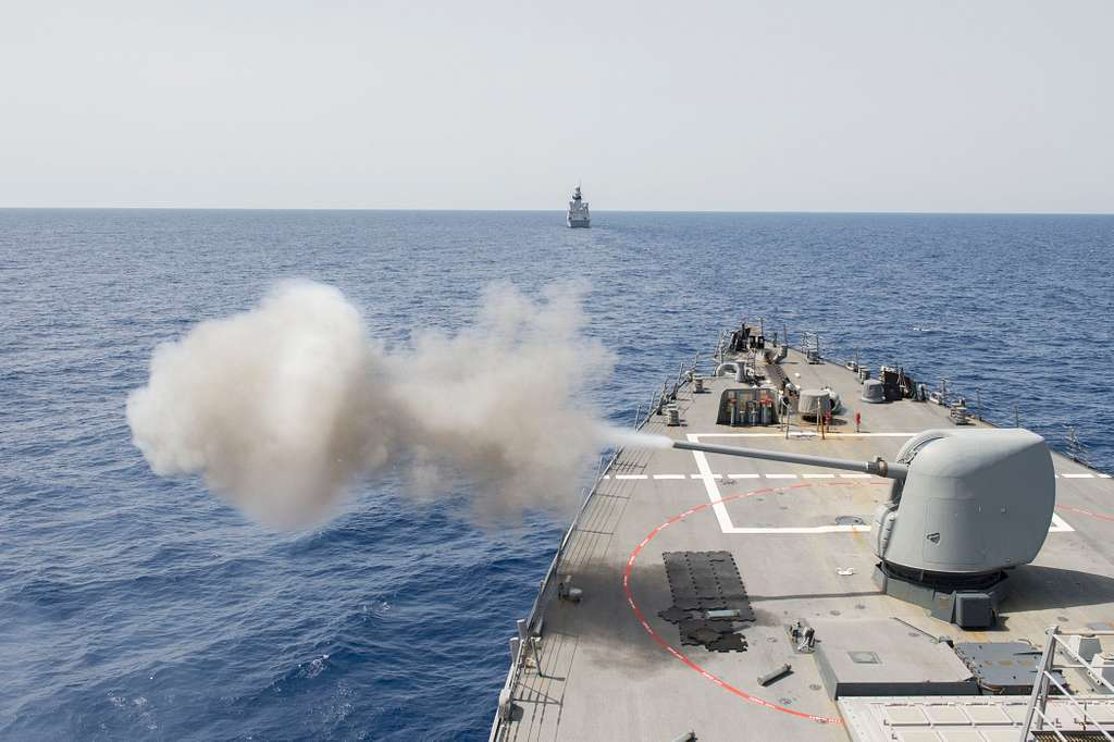 The guided-missile destroyer USS Laboon (DDG 58) fires its MK 45 5-inch lightweight gun during a passing exercise with the French navy Horizon-class frigate  FS Forbin (620).