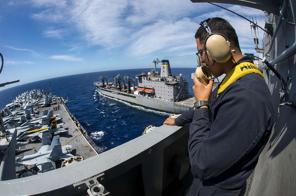 Seaman Ricky Silva, from New Orleans, acts as the forward lookout during a replenishment-at-sea.