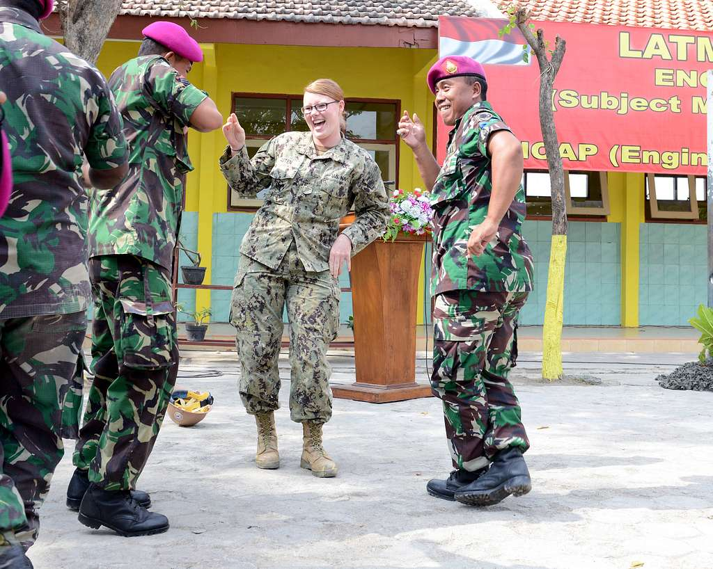 Steelworker Seaman Elizabeth Auten, dances with Indonesian marines after completing a renovation of SDN Tebalo Primary School during Cooperation Afloat Readiness and Training (CARAT) Indonesia 2015.