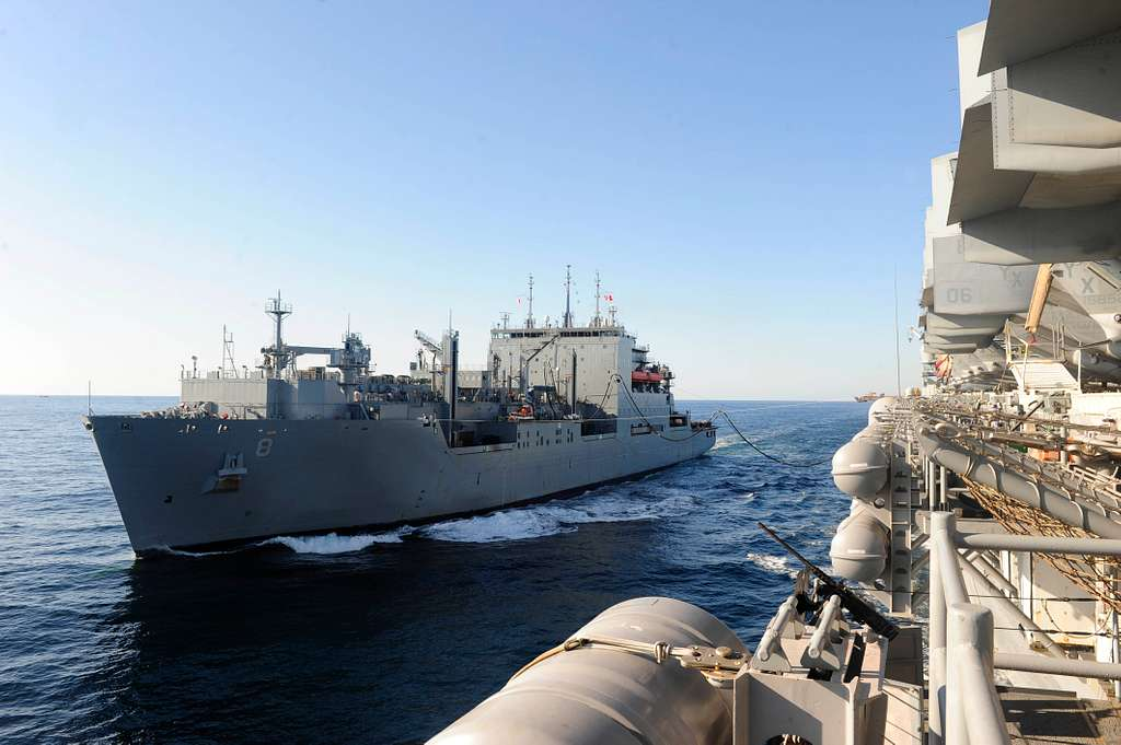 Military Sealift Command dry cargo and ammunition ship USNS Wally Schirra (T-AKE 8) steams alongside amphibious assault ship USS Boxer (LHD 4) during a replenishment at sea.