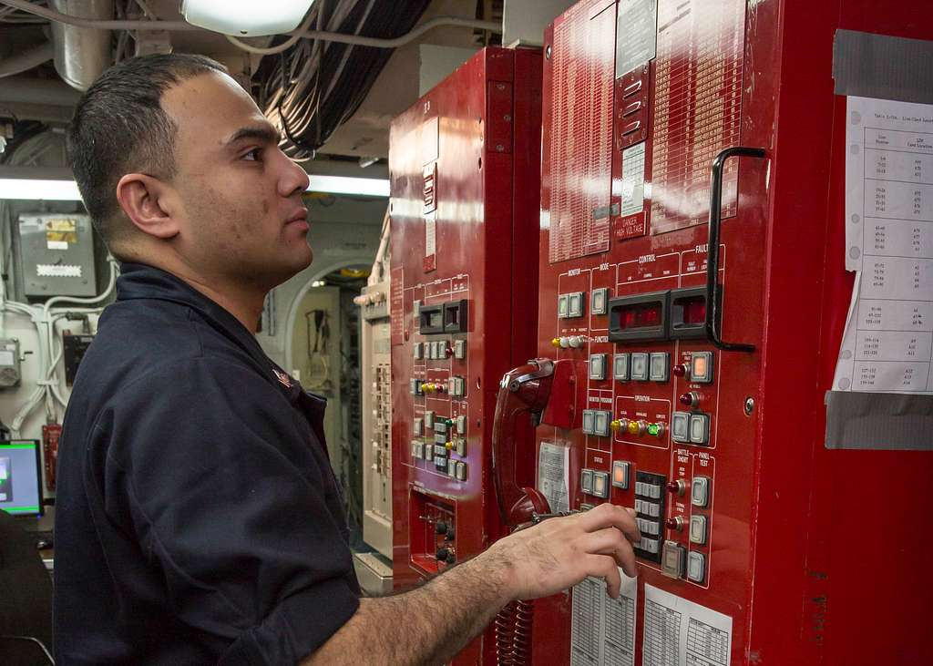 Information Systems Technician 3rd Class Robert Forman configures batching circuits in the technical control room aboard the amphibious assault ship USS Kearsarge (LHD 3).