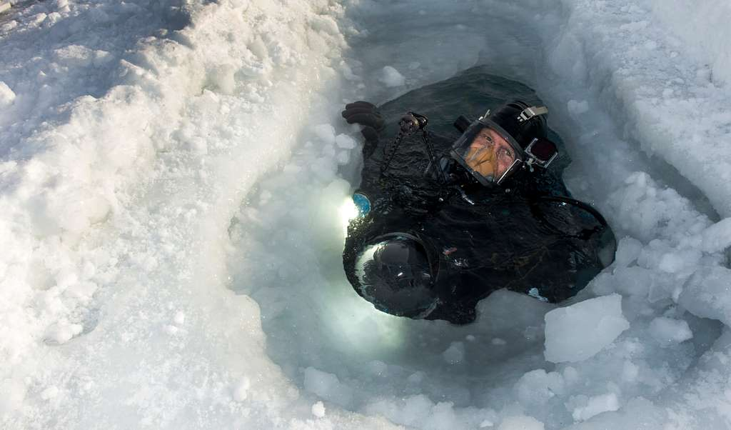 Navy Diver 1st Class Travis Arneson, assigned to Mobile Diving and Salvage Unit 2, completes a dive under the Arctic ice during Ice Exercise (ICEX) 2016.