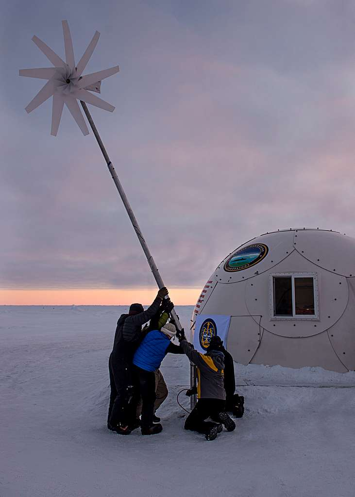 Sailors and civilians, assigned to the Arctic Submarine Lab, assemble a wind-powered turbine to supply some of Ice Camp Sargo with energy during Ice Exercise (ICEX) 2016.