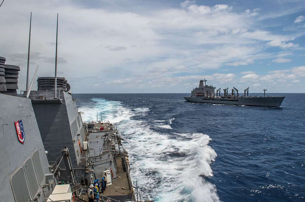 The forward-deployed Arleigh Burke-class guided-missile destroyer USS Barry (DDG 52) steams away from the Military Sealift Command (MSC) fleet replenishment oiler USNS Rappahannock (T-AO 204) after conducting an underway-replenishment.