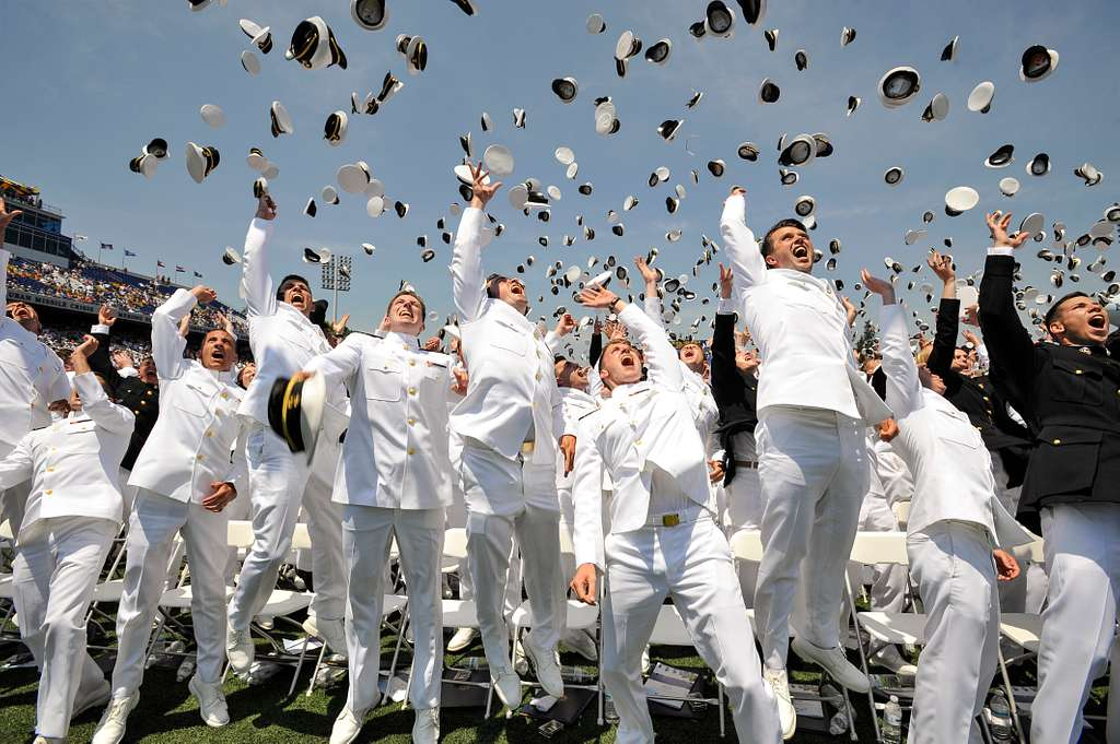 Newly commissioned Navy Ensigns and Marine 2nd Lieutenants from the U.S. Naval Academy Class of 2016 throw their midshipmen covers in the air