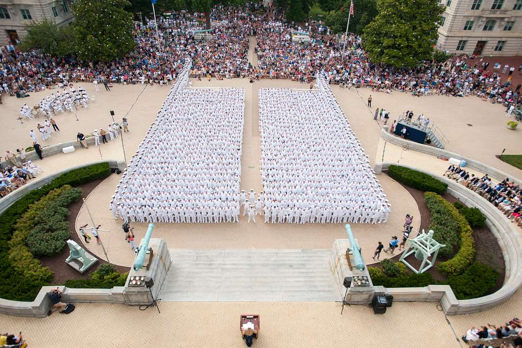 Incoming plebes from the U.S. Naval Academy (USNA) class of 2020 take the oath of office during induction day in Tecumseh Court before officially become Midshipmen, June 30, 2016.