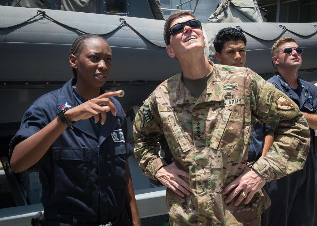 Boatswain's Mate 1st Class Tiffany Dallas speaks with Army Gen. Joseph Votel, Commander, USCENTCOM, during a tour of the amphibious transport dock ship USS New Orleans (LPD 18).