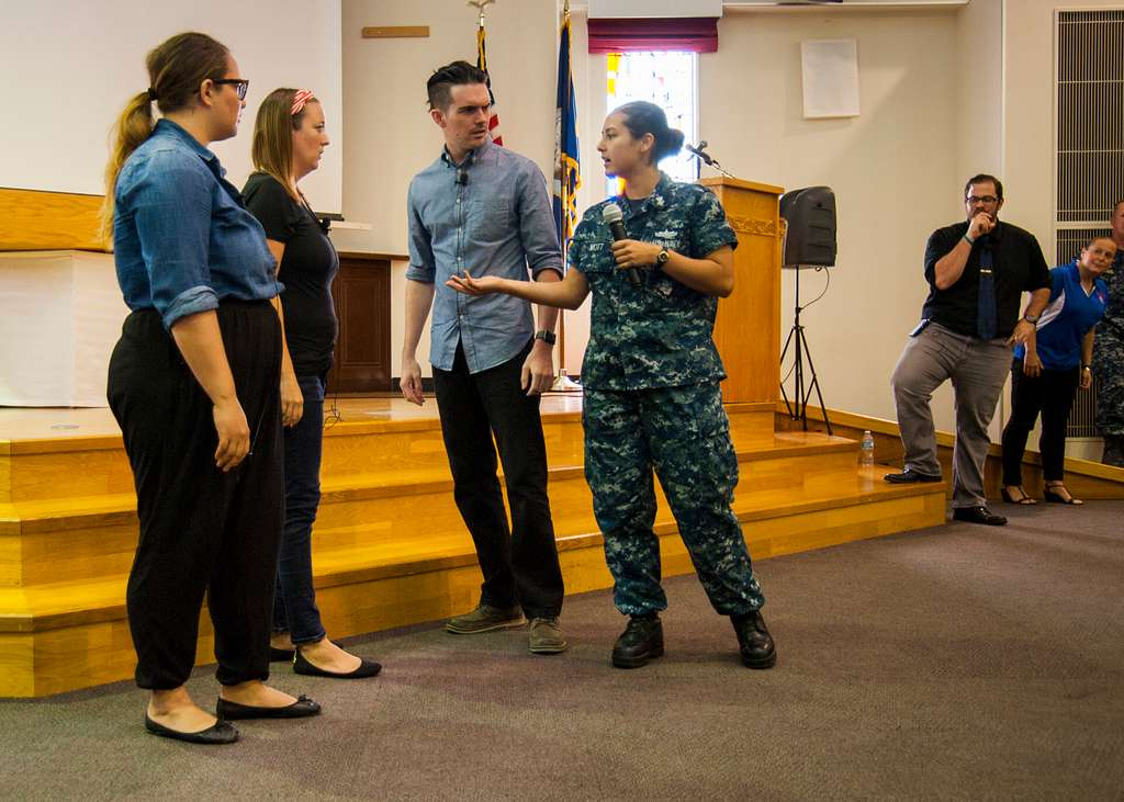 A Commander, U.S. Fleet Activities Sasebo Sailor participates in a Pure Praxis bystander intervention exercise.