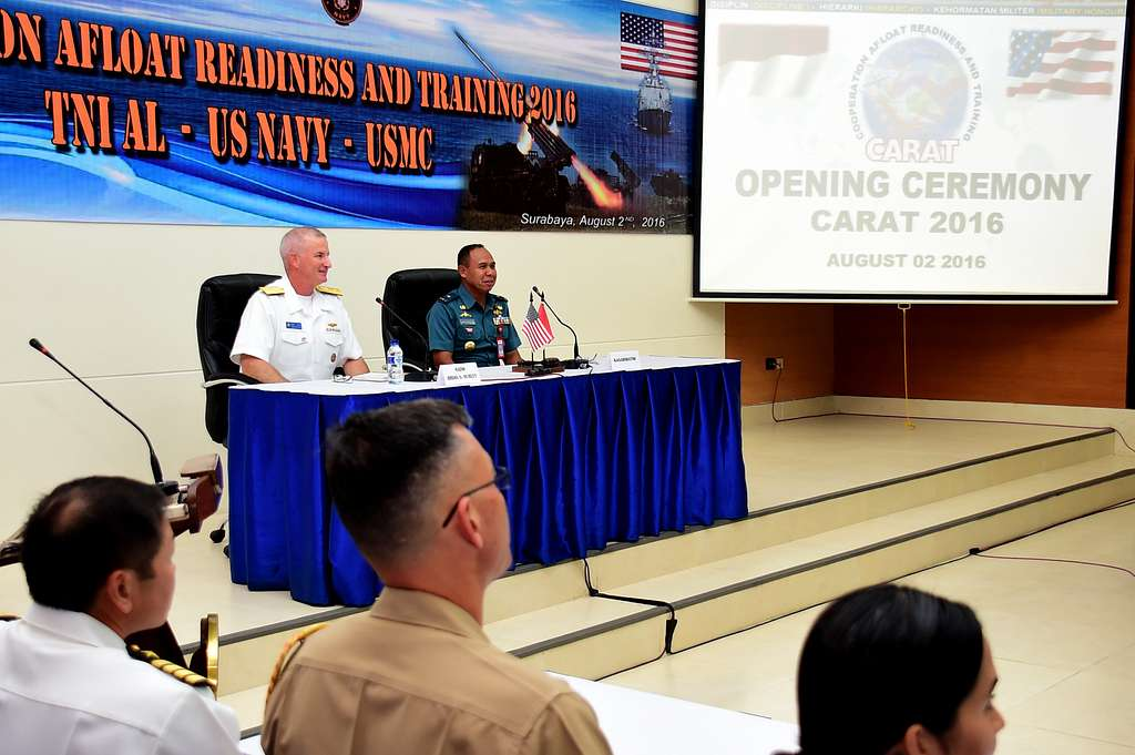 Rear Adm. Brian Hurley, Commander, Logistics Group Western Pacific, and 1st Adm. Mintoro Yulianto, Indonesian Navy (TNI-AL) Eastern Fleet Chief of Staff, preside over the opening ceremony of CARAT Indonesia 2016.