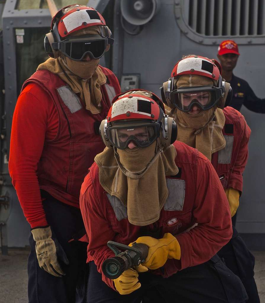Sailors conduct firefighting drills on the flight deck aboard the guided-missile destroyer USS Decatur (DDG 73).
