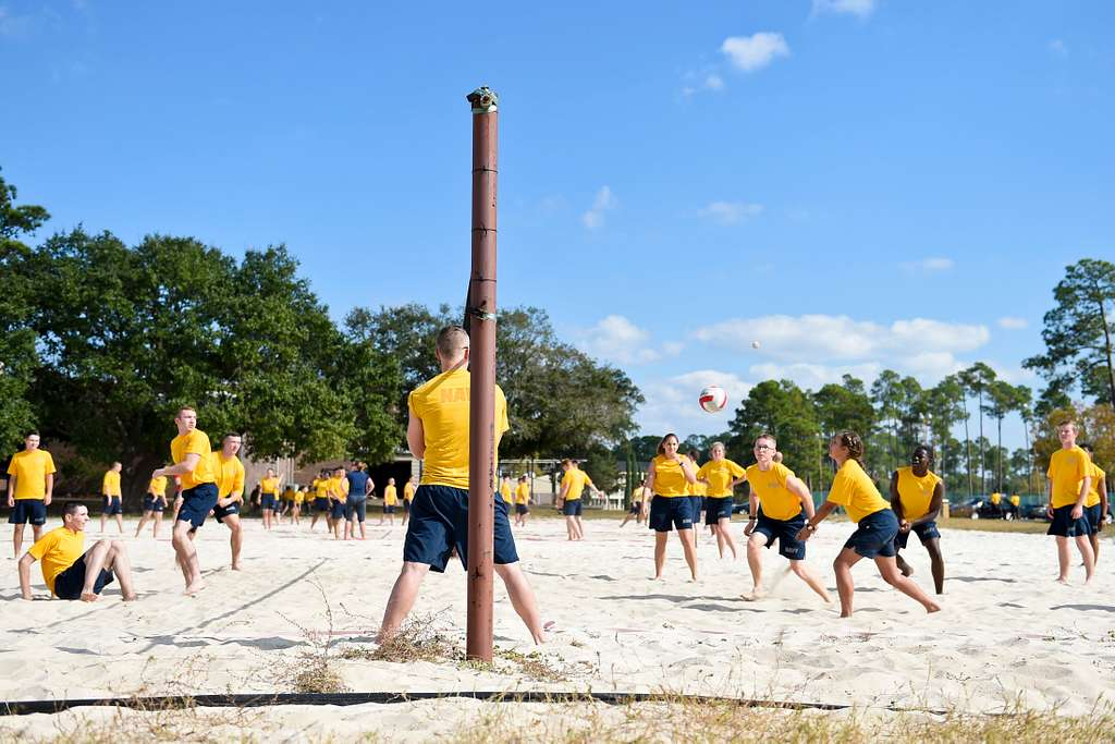 Sailors at Information Warfare Training Command (IWTC) Corry Station play volleyball during the command's