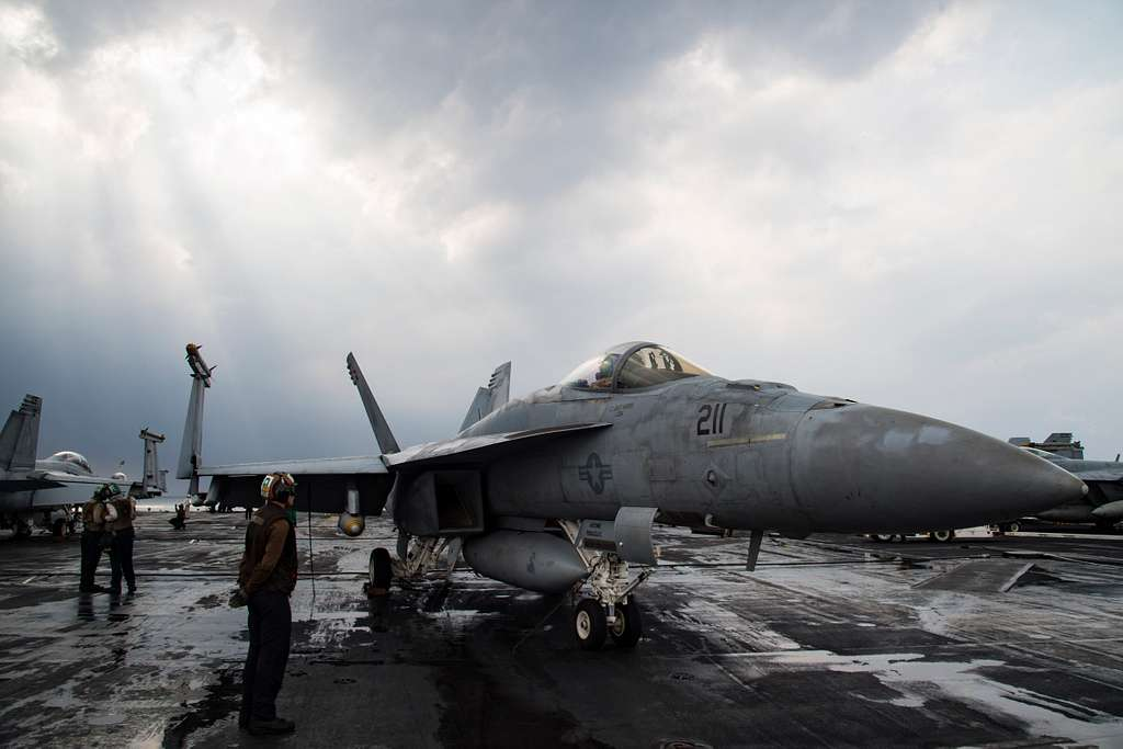An F/A-18E Super Hornet assigned to the Sidewinders of Strike Fighter Squadron (VFA) 86 is tied down to the flight deck of the aircraft carrier USS Dwight D. Eisenhower (CVN 69) prior to flight operations.