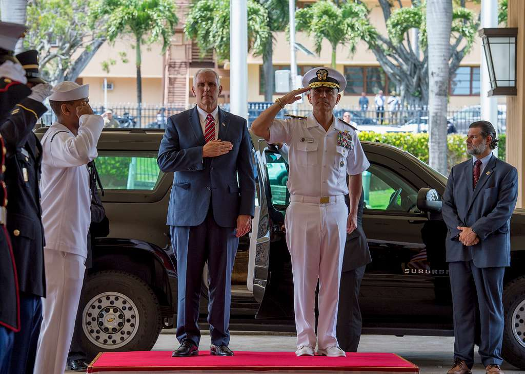 Vice President Mike Pence and Adm. Harry B. Harris Jr., commander, United States Pacific Command (USPACOM), render honors during the national anthem upon Pence's arrival at USPACOM headquarters.